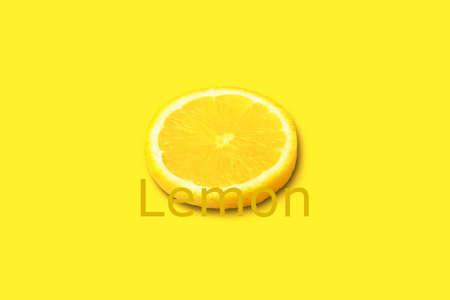 Lemon citrus slice on yellow background