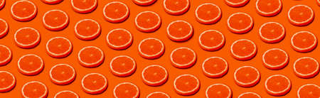 pattern with orange citrus fruits on a orange background, panoramic  image in pop art style