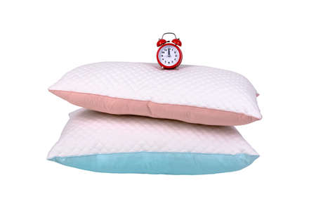 two modern pillows and red alarm clock isolated on white background, sleeping time concept 写真素材