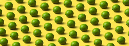 limes pattern on yellow  background, panoramic image