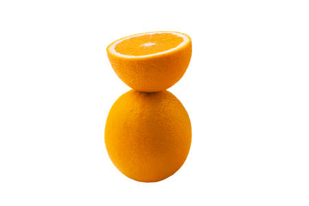 half sliced orange balancing on one whole orange isolated on white background