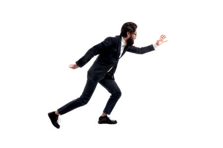 full length portrait of bearded, trendy businessman running isolated on white background, man pulls hand forward to catch something