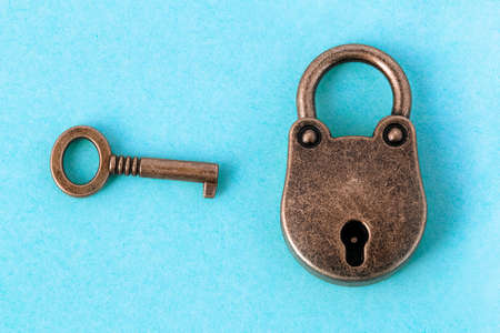 bronze lock and key on a blue background