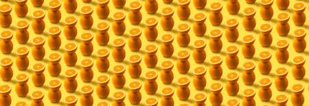 orange fruit pattern over yellow  background, panoramic image