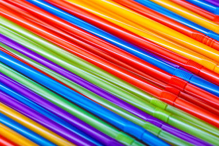 Colorful plastic drinking straws, close up background, summer cocktail accessories