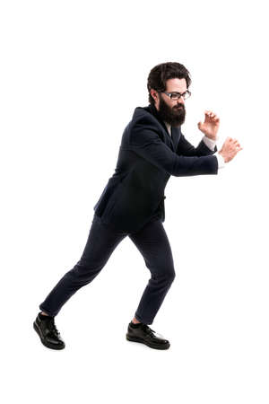 Full length portrait of a bearded businessman pulls an invisible rope, isolated on white background