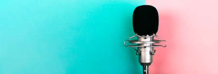 studio microphone on a colorful background, panoramic mock-up with space for text Imagens