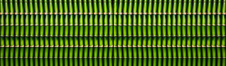 a lot of green bamboo sticks formed into a single background