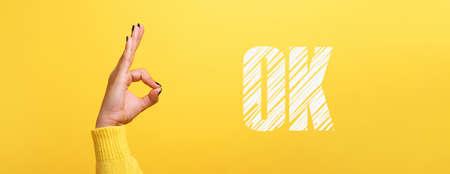 ok inscription over trendy yellow background, panoramic image 免版税图像