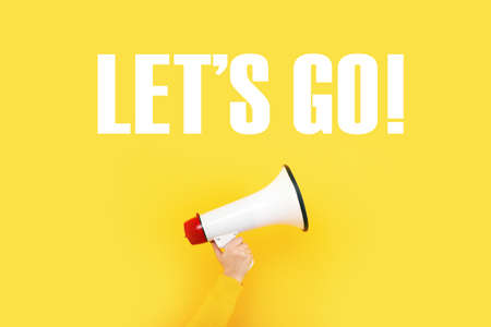 megaphone in hand and inscription lets go on a yellow background