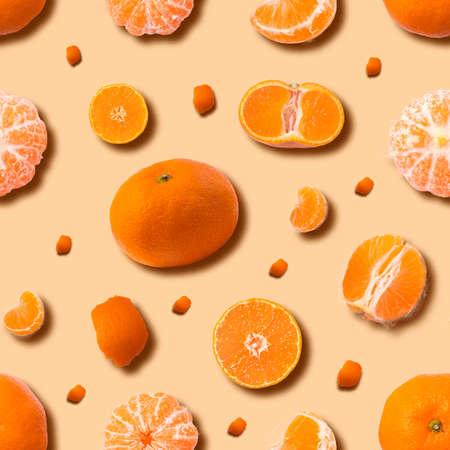 Fruit seamless pattern of fresh orange tangerine or mandarin on yellow background. Flat lay, top view. Pop art design, creative summer concept. Citrus