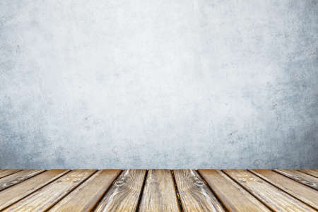 empty wooden table on gray wall background