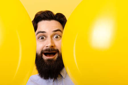 bearded man with balloons, positive mood concept, guy with accessories for birthday or party 免版税图像