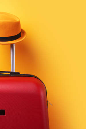 Suitcase with hat over yellow background minimal creative travel concept 免版税图像 - 152126318