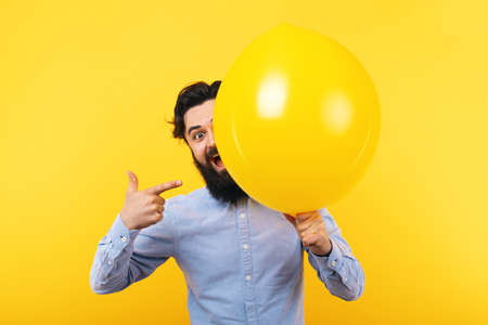 Bearded man with balloon