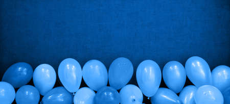 Blue balloons on blue