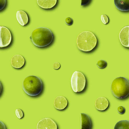Fresh slices lime on  light green seamless pattern