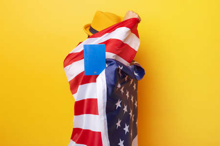 A person with American flag over yellow