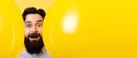 Bearded man with balloons