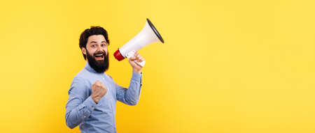 hipster man with megaphone over yellow background, success concept, panoramic mock-up
