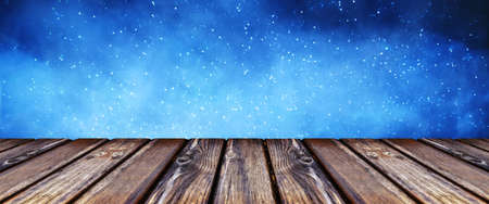 empty wooden table on the background of the starry sky, panoramic mock-up