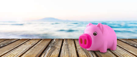 Pink piggy bank on wooden board 写真素材