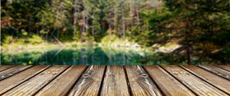 empty wooden table on background of summer forest, panoramic image