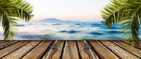 empty wooden table on background of sea, panoramic image
