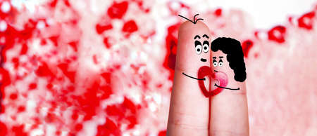 fingers with painted faces and hair with a heart in hands, the concept of lovers, blank for Valentine's Day