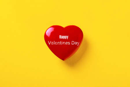 Happy Valentines Day inscription over red heart, love concept