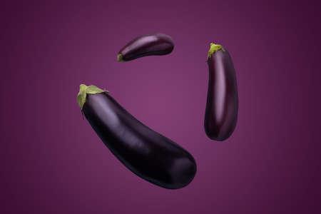 three eggplants on purple background