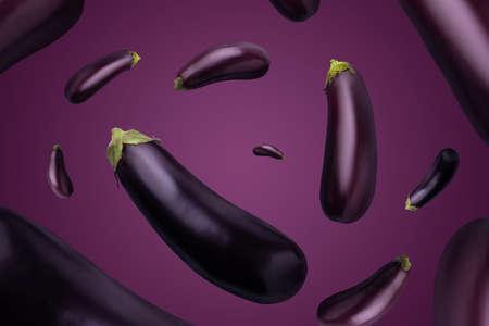 Whole eggplants on a purple background