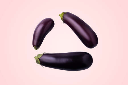 Whole eggplant on a pink background