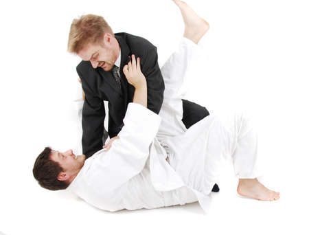 judoist fight together with businessman