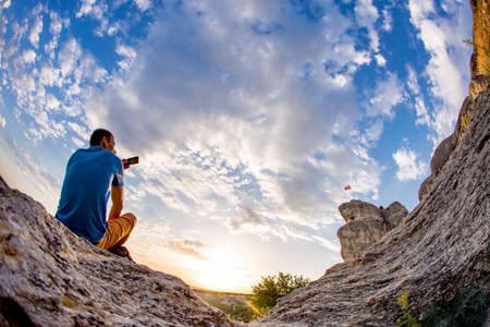 Man making photo of  blue sky background. Wide angle view.