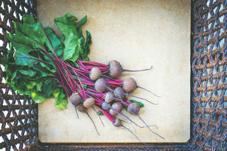Fresh raw bunch of beetroot in wooden bos.