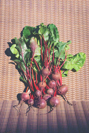 Frech raw bunch of beetroot on rattan background.