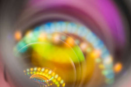 Vivid bright colored abstract background with blurred circule shaped  light spots. Imagens