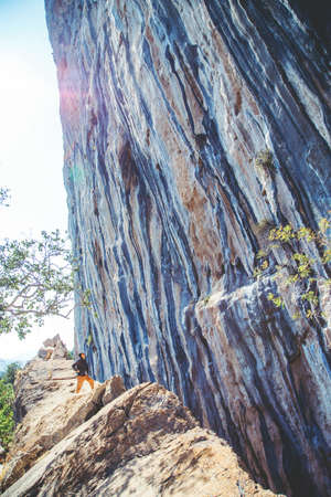 Athletic man looking at pitch on the big wall rock in Turkey. Sport climbing, lead.