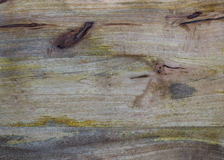 taint: Aged wood rough background with yellow and dark brown taint and scratches