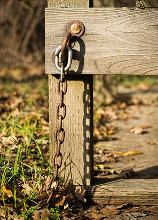 Wooden bench chained to the ground