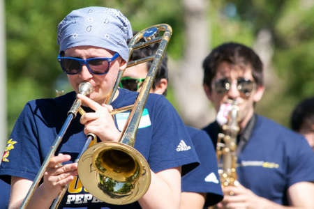pep: Davis, California, U.S.A. 16th April 2016. Davis High School Pep Band at the UC Davis picnic day parade. Picnic Day an annual event featuring UC Davis departments and services, and attracts hundreds of people to the small town of Davis, California, editor