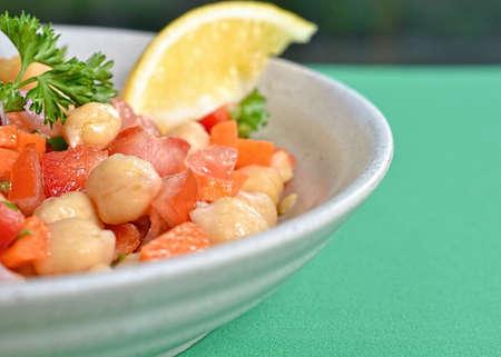garbanzo bean: Closeup on garbanzo bean salad on green tablecloth