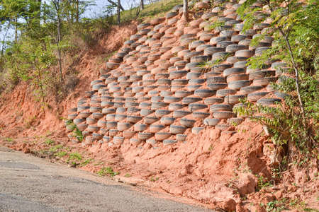 deforested: Erosion and landslide control with the use of tires on sand and clay slopes