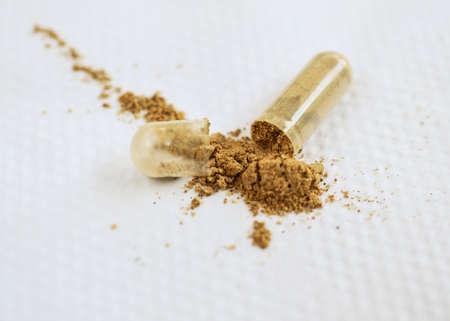 An open tablet of guanara supplement on white napkin