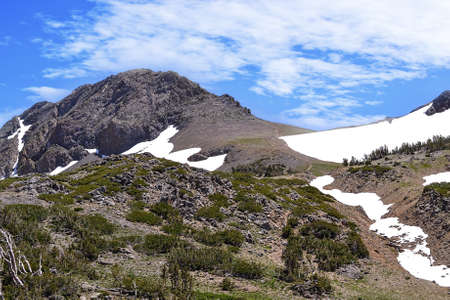 sierras: Mountains on trail to Winnemucca Lake from High Top Lake, in the summer,  featuring mostly melted snow packs