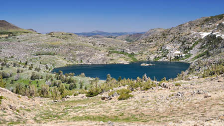 sierras: High Top Lake in the summer,  featuring mostly melted snow packs Stock Photo
