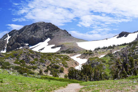 Trail to Winnemucca Lake from High Top Lake in the summer,  featuring mostly melted snow packs Stock Photo