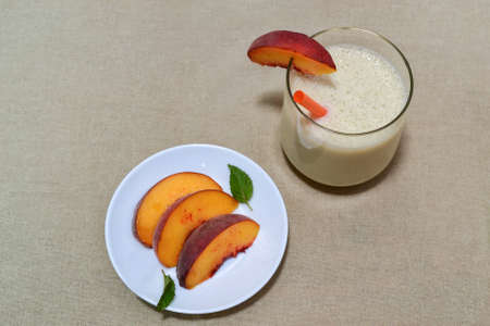 sac: Sliced peaches and peach smoothie on flower sac background