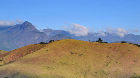 deforested: Panoramic view of deforested hill used for pasture, and mountains in the background, in Itaipava, Petropolis. The pasture was formerly occupied by Atlantic forest Stock Photo